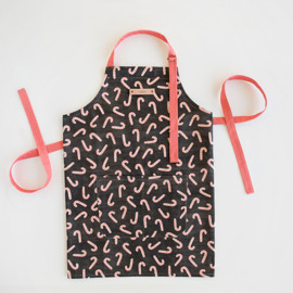 This is a black apron by Hooray Creative called Assorted Candy Canes.