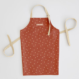 This is a orange apron by Cindy Lackey called Golden Triangle.