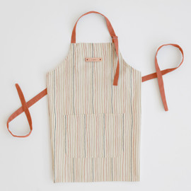 This is a colorful apron by Multiple Artists called Strands of Tradition in standard.