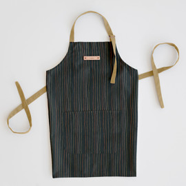 This is a blue apron by Multiple Artists called Strands of Tradition 2 in standard.
