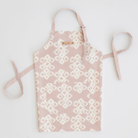 This is a pink apron by Zhay Smith called Marrakech Diamond in standard.