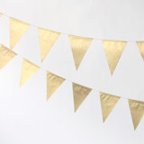 This is a gold wedding garland by Minted called Gold Triangle 30-ft..