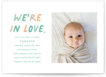 This is a green baby shower postcard by Louise Kay called We're In Love with standard printing on signature in postcard.