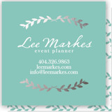 This is a green business card by Blustery August called Pretty Ink Wreath printing on signature.