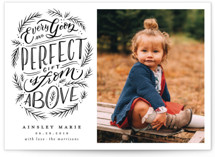 This is a black and white babys first christma by Wildfield Paper Co. called Every Good Perfect Gift From Above with standard printing on signature in standard.
