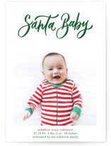 This is a green babys first christma by Elsa Duncan called Santa Baby Hand Lettered with standard printing on smooth signature in standard.