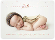 This is a red babys first christma by Julie Murray called Little Script with standard printing on smooth signature in standard.