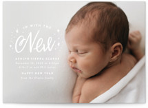 This is a white babys first christma by Ink and Letter called In With the New with standard printing on signature in standard.