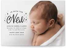 This is a black babys first christma by Ink and Letter called In With the New with standard printing on signature in standard.