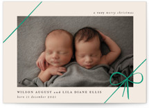 This is a green babys first christma by Rebecca Daublin called Gifts with standard printing on smooth signature in standard.