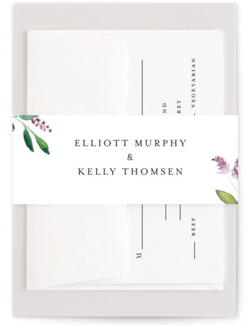 This is a pink Belly Bands by Mere Paper called Spring Wildflowers with Standard printing on Signature Text in Belly Band Flat Card format. Watercolored wild flowers create an asymmetrical frame on this wedding invitation.