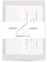 This is a white belly band by Minted called Polished Ampersand with standard printing on signature text in belly band.