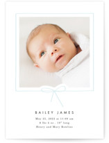 This is a blue letterpress birth announcement by Baumbirdy called Little Bow with letterpress printing on bright white letterpress paper in standard.