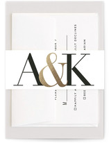 This is a gold belly band by Minted called Bold Ampersand with foil-pressed printing on signature text in belly band.