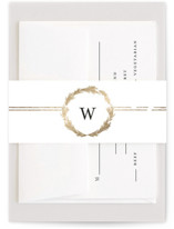 This is a gold belly band by Phrosne Ras called Little Wreath with foil-pressed printing on signature text in belly band.