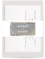 This is a grey belly band by Hooray Creative called Slate with foil-pressed printing on signature text in belly band.