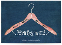 This is a blue will you be my bridesmaid card by Cass Loh called bridesmaid hanger with standard printing on signature in standard.