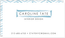 This is a blue business card by Laura Condouris called Herringbone Stroke printing on signature.