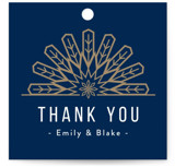 This is a blue gift tag by Melanie Kosuge called RADIAL with standard printing on signature in tag.