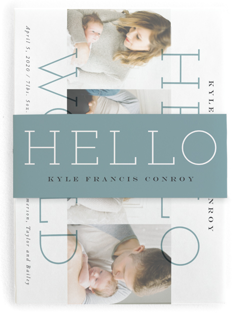 This is a blue birth announcement belly band by Carrie ONeal called Morning + Night with standard printing on signature text in belly band.