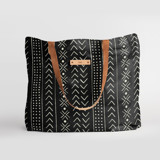 This is a black carry all tote by Erin Deegan called mud cloth organic.