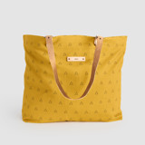 This is a yellow carry all tote by Erika Firm called Espace Triangle.