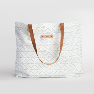 This is a white carry all tote by Carolyn Nicks called Coastal in standard.