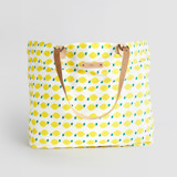 This is a yellow carry all tote by Erica Krystek called Lemon Squeezy.