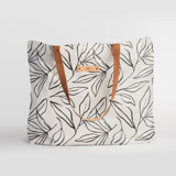 This is a black and white carry all tote by Cass Loh called ink line leaves.