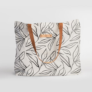This is a black and white carry all tote by Cass Loh called ink line leaves in standard.
