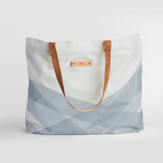 This is a blue carry all tote by Roopali called Crisscross in standard.