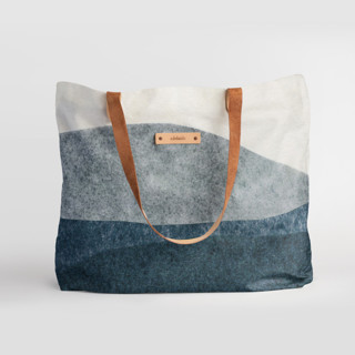 This is a blue carry all tote by Carrie Moradi called tissue overlay in standard.