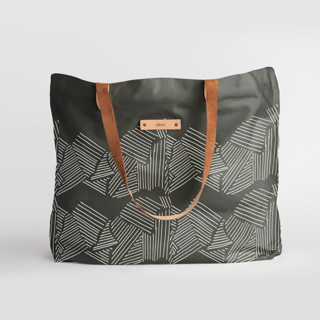 This is a black carry all tote by Deborah Velasquez called Savanna Grassland.