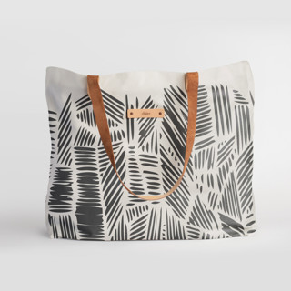 This is a black carry all tote by Oma N. Ramkhelawan called Streetwise.