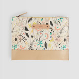 This is a yellow hand clutch bag by Eve Schultz called Wildflower Meadow.