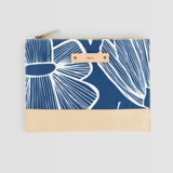 This is a blue hand clutch bag by Beth Schneider called Lined Florals.