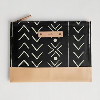 This is a black hand clutch bag by Erin Deegan called mud cloth organic.