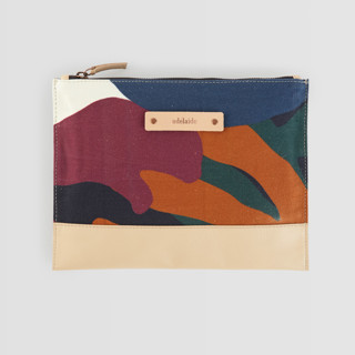 This is a purple hand clutch bag by Amina Taylor called When Frankie Met Flora in standard.