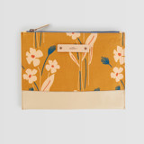 This is a yellow hand clutch bag by Alex Roda called Mustard bouquet.