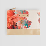 This is a pink hand clutch bag by Lori Wemple called Floral Bouquet.