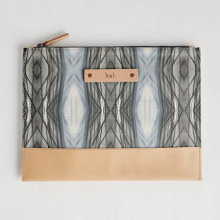 This is a brown hand clutch bag by Angela Simeone called Ikat Stripe in standard.