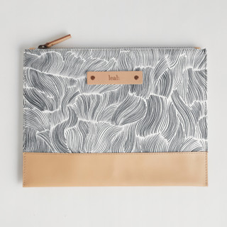 This is a black and white hand clutch bag by Vivian Yiwing called Breeze.