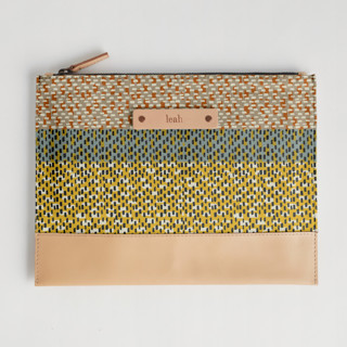 This is a yellow hand clutch bag by Bethania Lima called Basic 3.