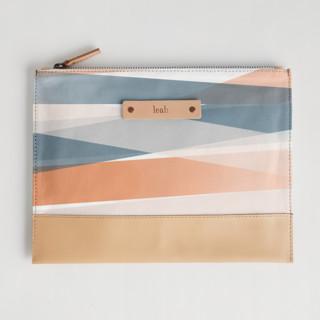 This is a blue hand clutch bag by Stephanie C Martinez called Pastel Beach.