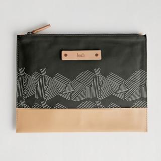 This is a black hand clutch bag by Deborah Velasquez called Savanna Grassland in standard.