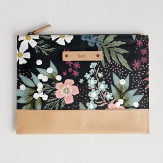 This is a black hand clutch bag by Alethea and Ruth called Wildflower Scatter.