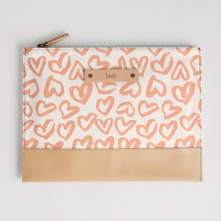 This is a pink hand clutch bag by Ariel Rutland called Heart Flutter in standard.