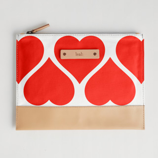This is a red hand clutch bag by kelli hall called Big Heart in standard.