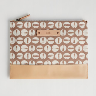 This is a brown hand clutch bag by Carrie ONeal called Penny Thoughts in standard.