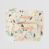 This is a yellow zipper pouch by Eve Schultz called Wildflower Meadow.